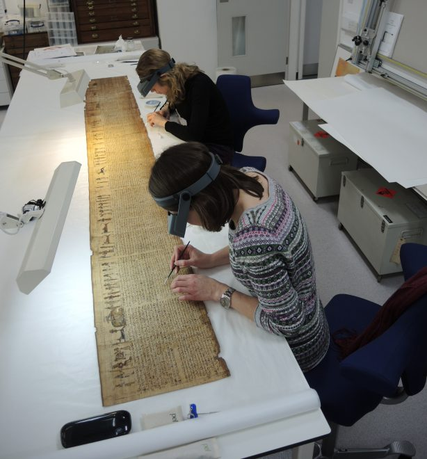 Fig 4 Paper Conservators - Lisa Cumming and Victoria Hanley consolidating media and papyrus.
