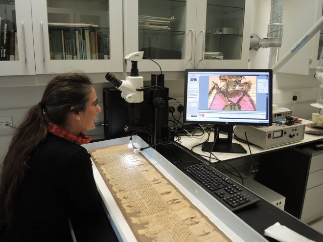 Fig 7 National Museums Scotland's Analytical Scientist, Dr. Lore Troalen working with the stereo microscope.