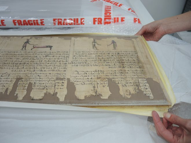 Fig. 2 Details showing poor framing and cockled brown card backings.