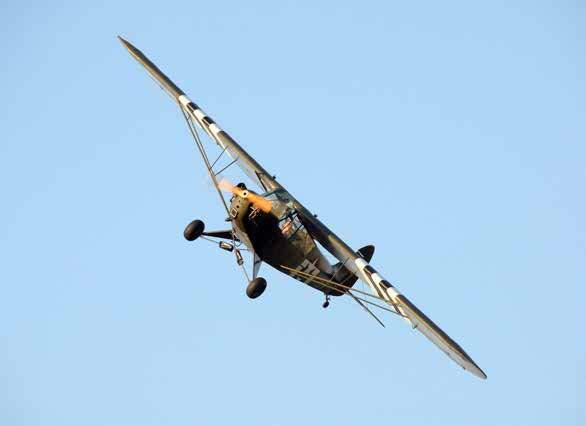 Jim McTaggart flying his Piper J-3 Cub above North Berwick. © Simon Grosset