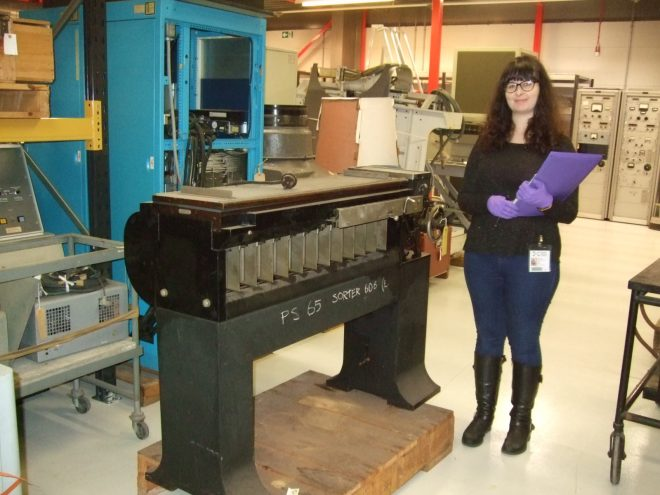 Sophie with one of the punch card machines.