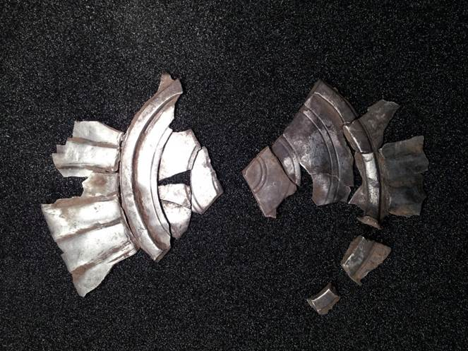 Fragments of the two packages of fluted bowl being pieced together