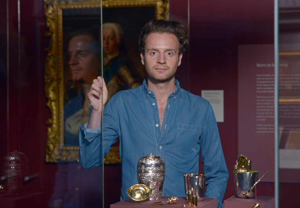 Actor Andrew Gower, who plays Prince Charles in Outlander, with the canteen. You can see it in the exhibition Bonnie Prince Charlie and the Jacobites, which runs at the National Museum of Scotland until 12 November 2017.