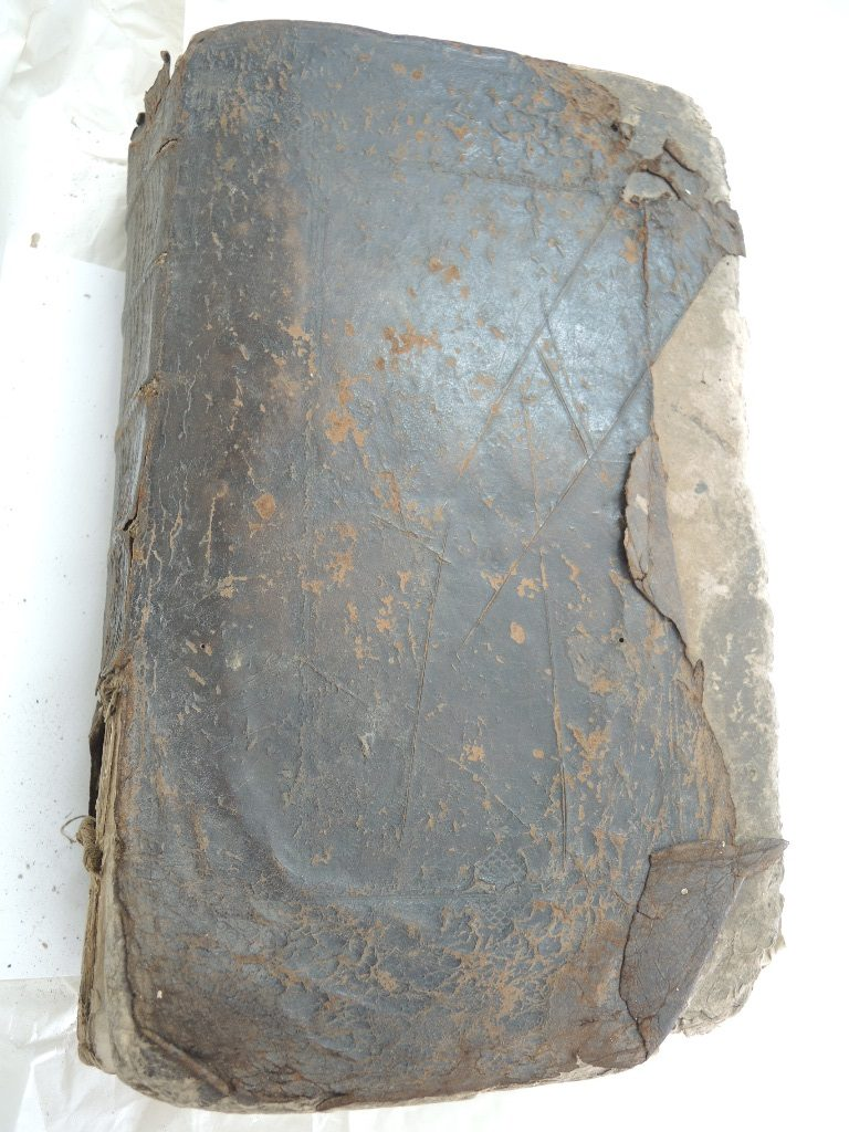 Showing 'Broadsword' marks and damage to the leather cover.
