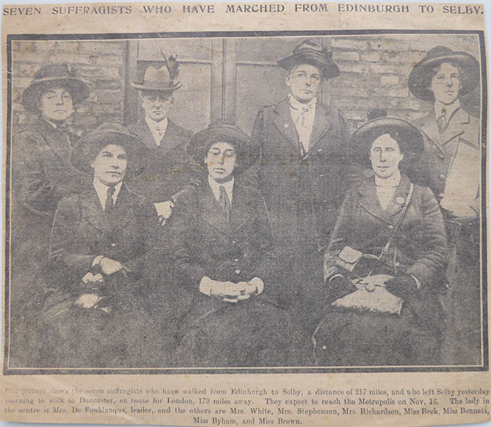 Newspaper cutting showing Nannie Brown seated on the front row, on the right.
