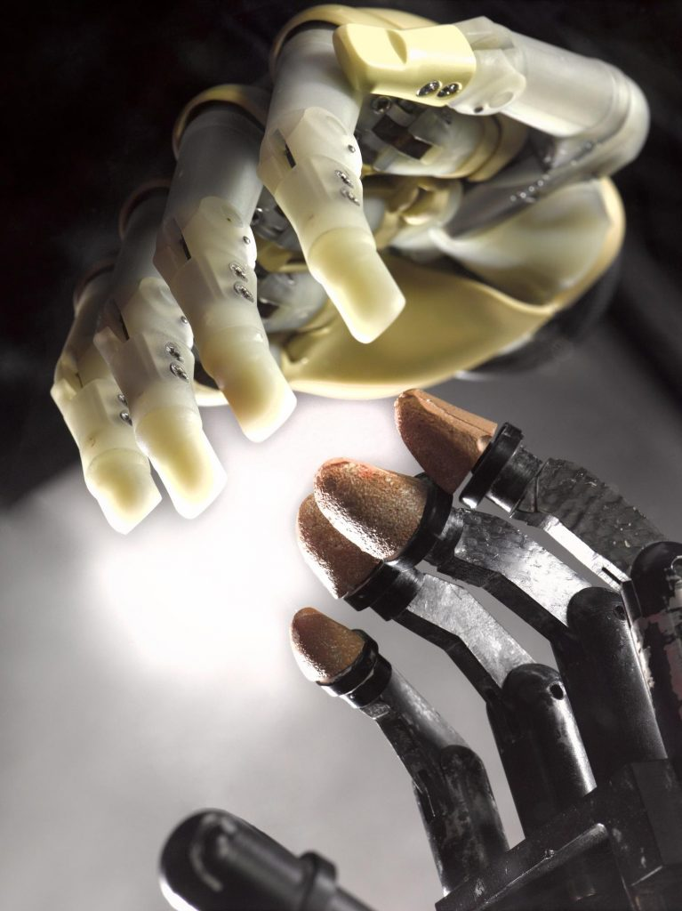 The EMAS bionic arm with the first generation i-limb.