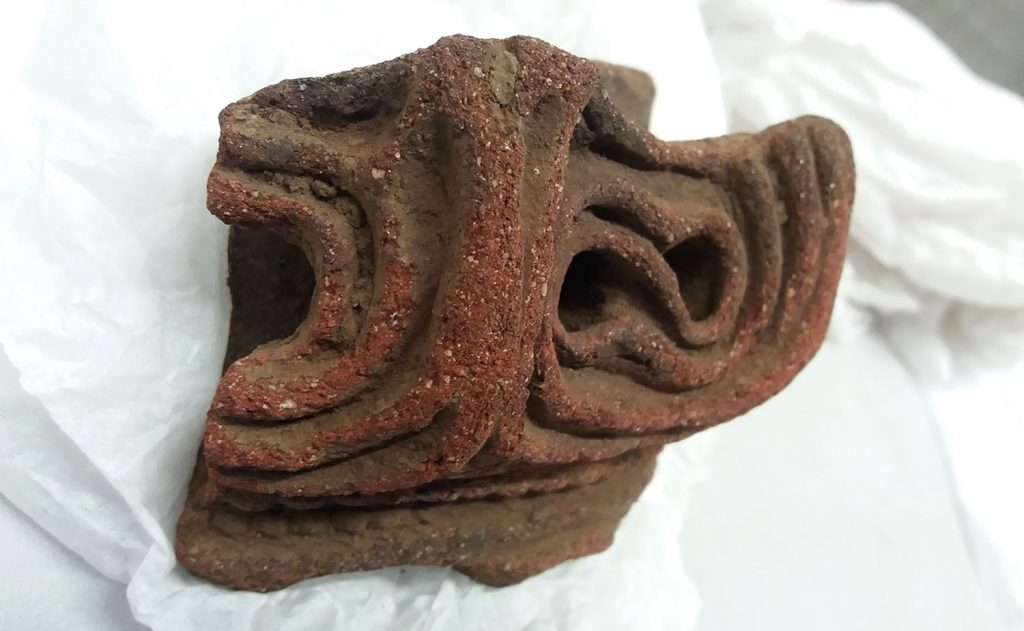 A rim fragment from a Late Jōmon pot. The hollow rim makes for a cavernous spider home
