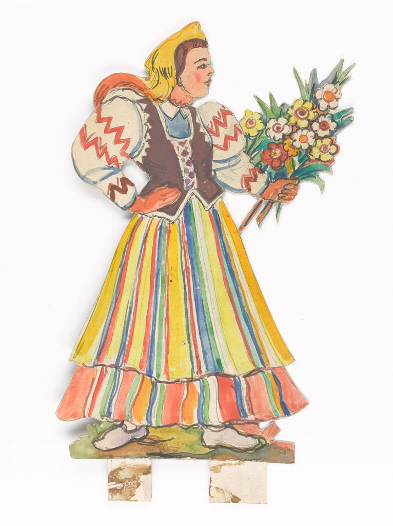 A flower bearing woman in a folk costume of central Poland.