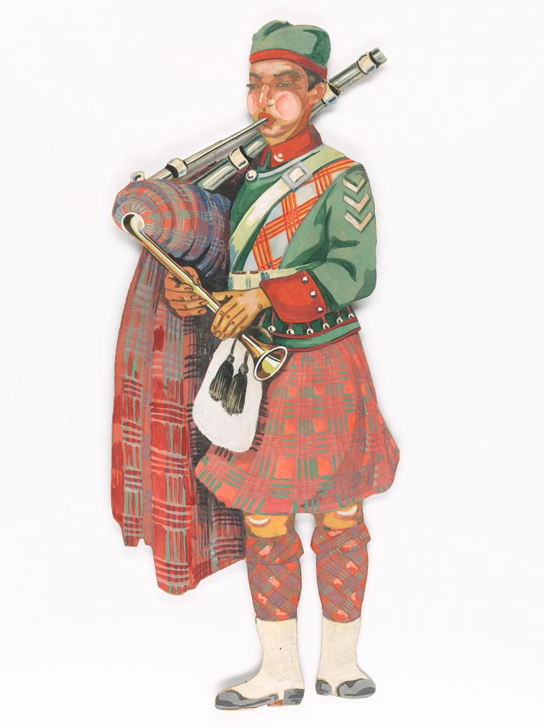 A Scottish Piper resplendent in his somewhat imaginary uniform.
