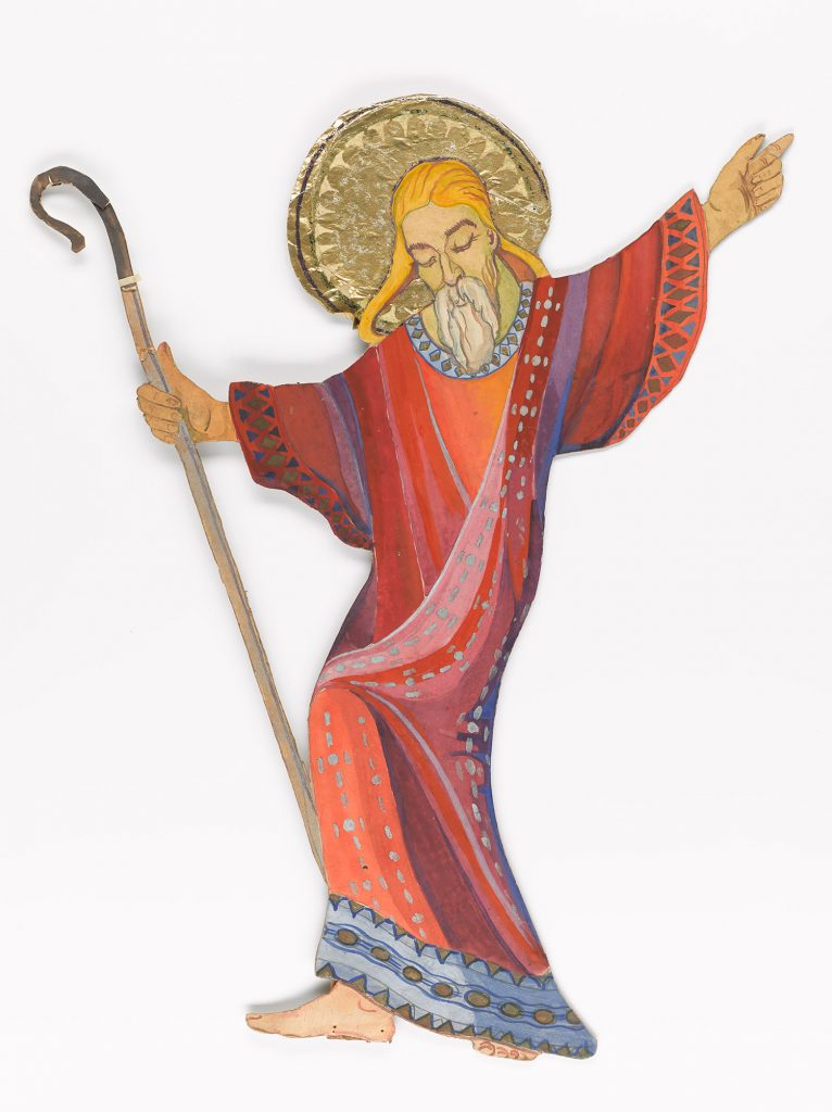 Joseph, shown standing, holding a shepherds crook, arm outstretched in blessing.