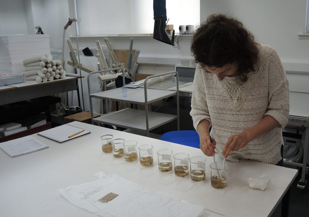Testing different recipes of cleaning solutions on linen samples prior testing on the actual object to determine the possible outcomes/