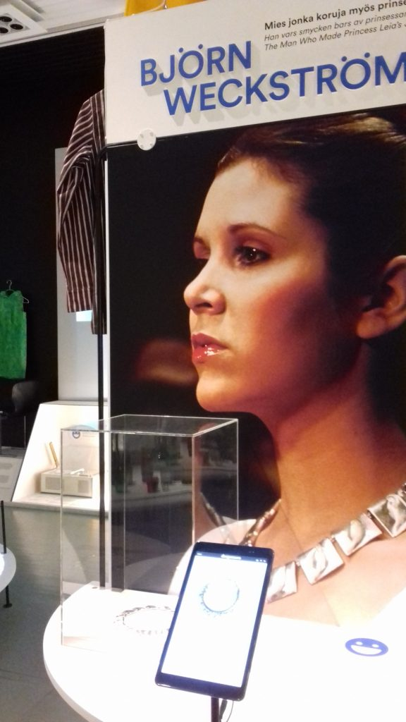 Display featuring Princess Leia (Carrie Fisher) wearing Planetoid Valleys necklace designed by Björn Weckström, within Designmuseo, Helsinki
