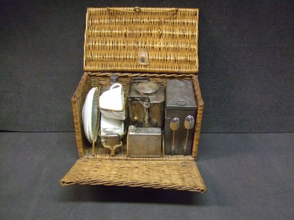The china tea set packed up in its wicker case.