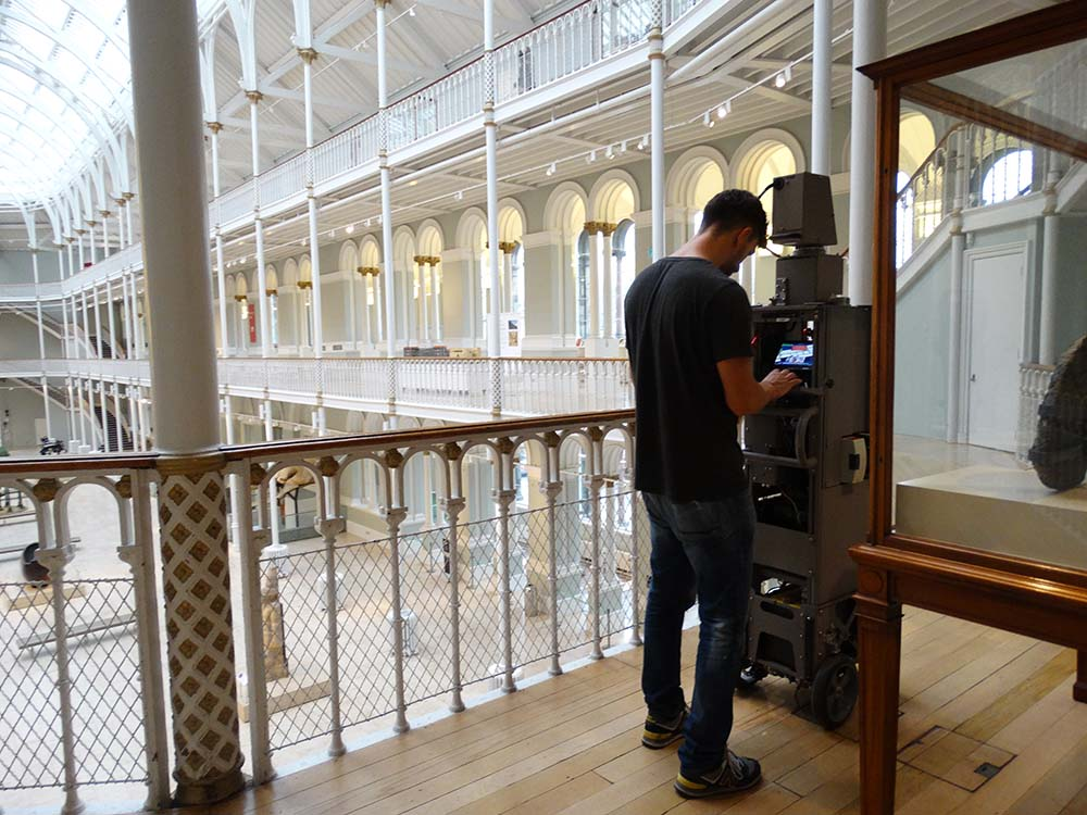 A photographer uses the Google trolley camera to capture the Grand Gallery at the National Museum of Scotland