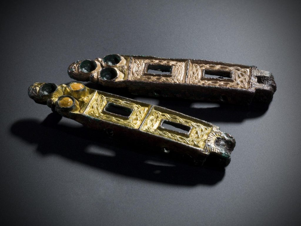 Two hinge-fasteners from an Insular house-shaped shrine, 8th century, later converted for use as brooches in the Viking burial at Carn A' Bharraich, Oronsay, 9th century