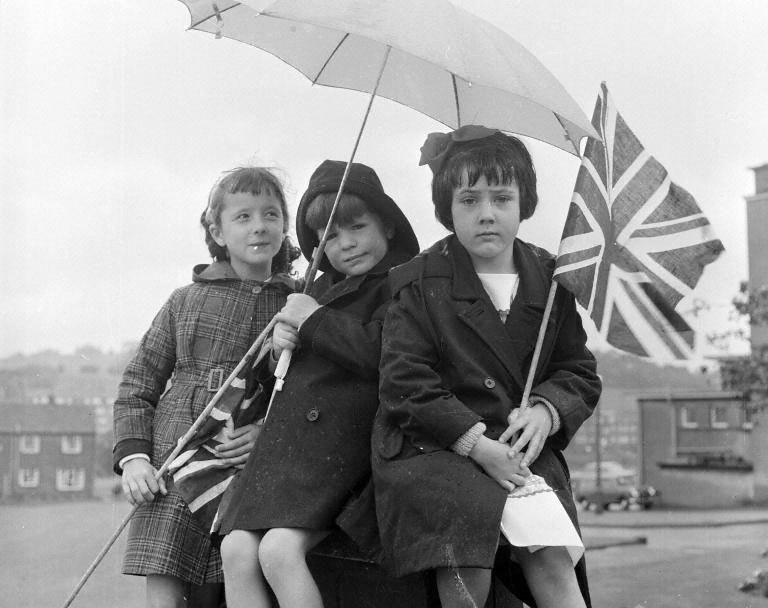 Pupils from Blacklaw School with umbrellas as Dunfermline Gala Day is cancelled, 24 June 1961. © The Scotsman Publications Ltd. (Original glass plate negative held in the Scottish Life Archive.)