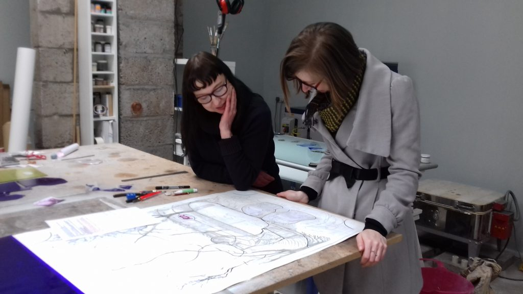 Pinkie Maclure explaining her latest commission to Bryony Windsor, Head of Exhibitions, NCCD, at her studio in Perthshire, 2017 © Sarah Rothwell