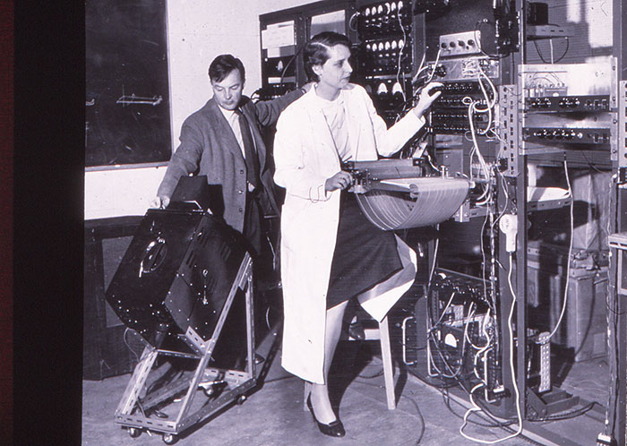 Researchers James Anthony and Dr Frances Ingemann operating PAT, c.1958. It was Dr Ingemann's work which isolated the six speech parameters needed to produce speech sounds from PAT.