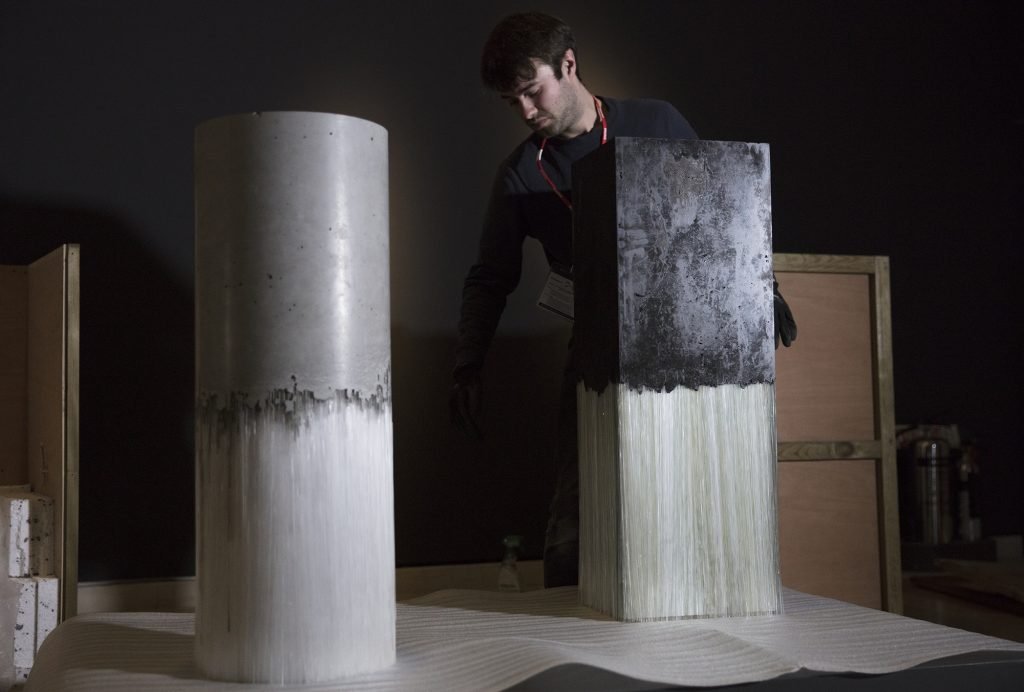 Harry Morgan installing his piece Dichotomy I, 2017 & Dichotomy II, 2018 in the Art of Glass exhibition.