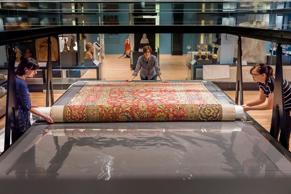 Unrolling the carpet in its new home in the Art of Living gallery