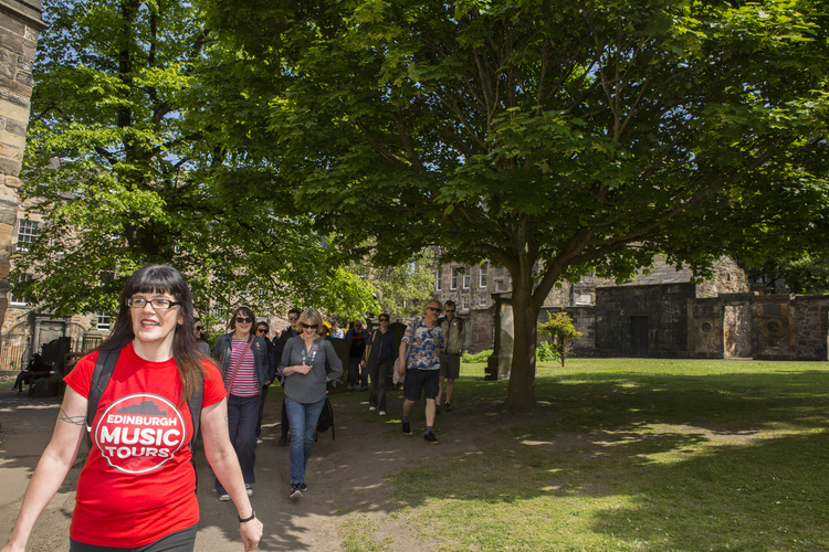 Guide Fiona Shepherd with guests in Greyfriars Kirkyard. Pic Jannica Honey