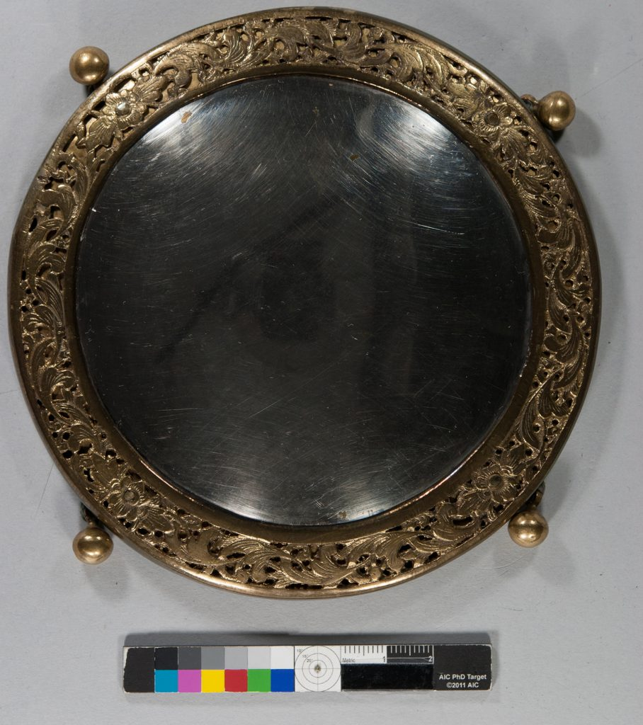 One of the silver medallions after conservation.