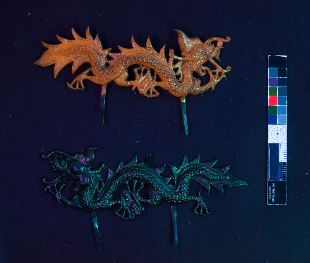 Two of the plain dragon attachments of the helmet under UV light.
