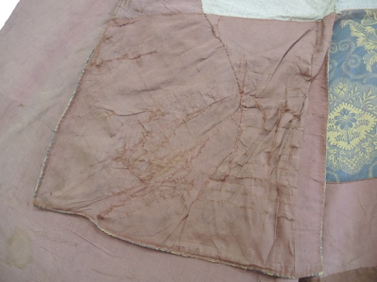 Detail of waistcoat, after conservation.
