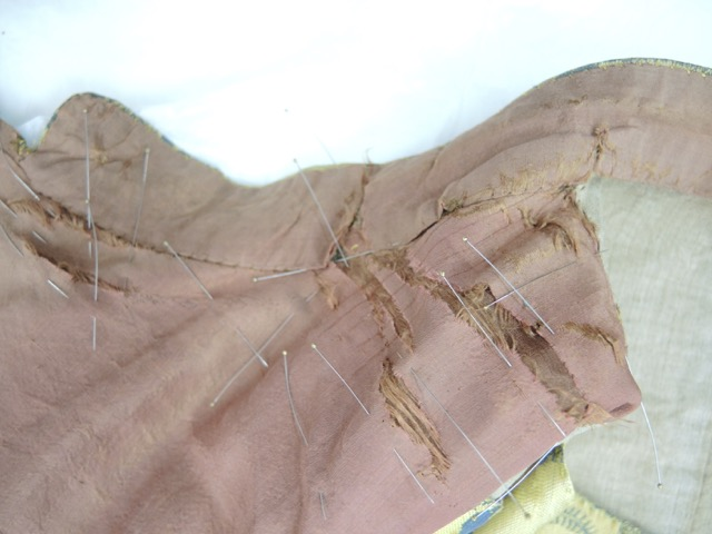 Damage on the collar, in progress.