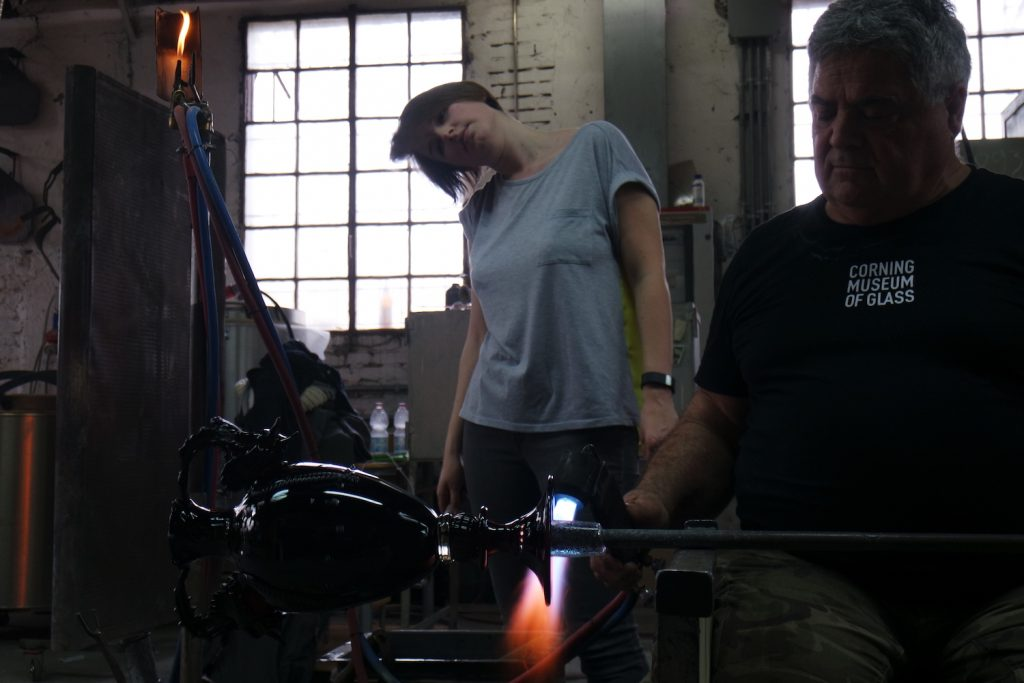 Erin watching Silvano Signoretto complete the first piece at the Berengo Studios, Murano, Italy Photo: Erin Dickson