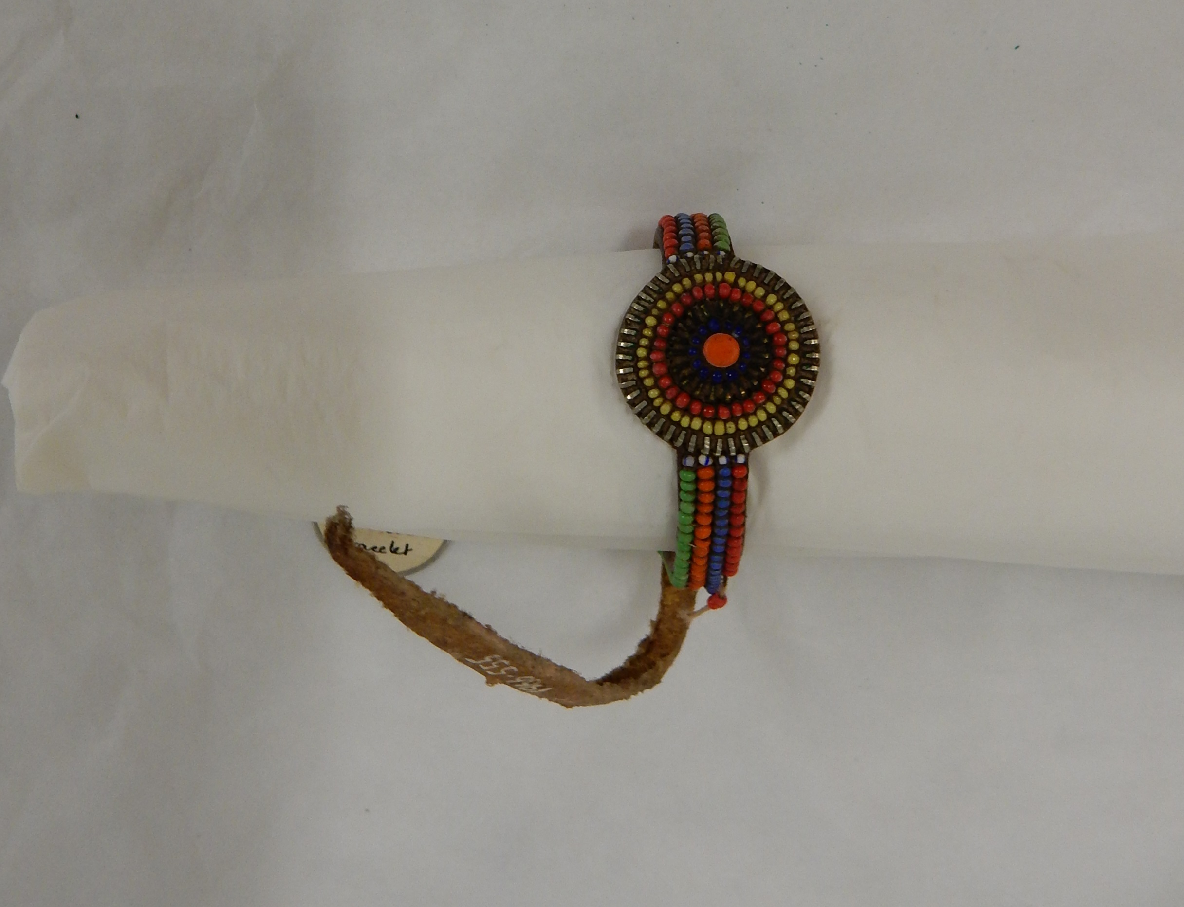 Woman's leather bracelet decorated with beads, in form similar to a wrist watch