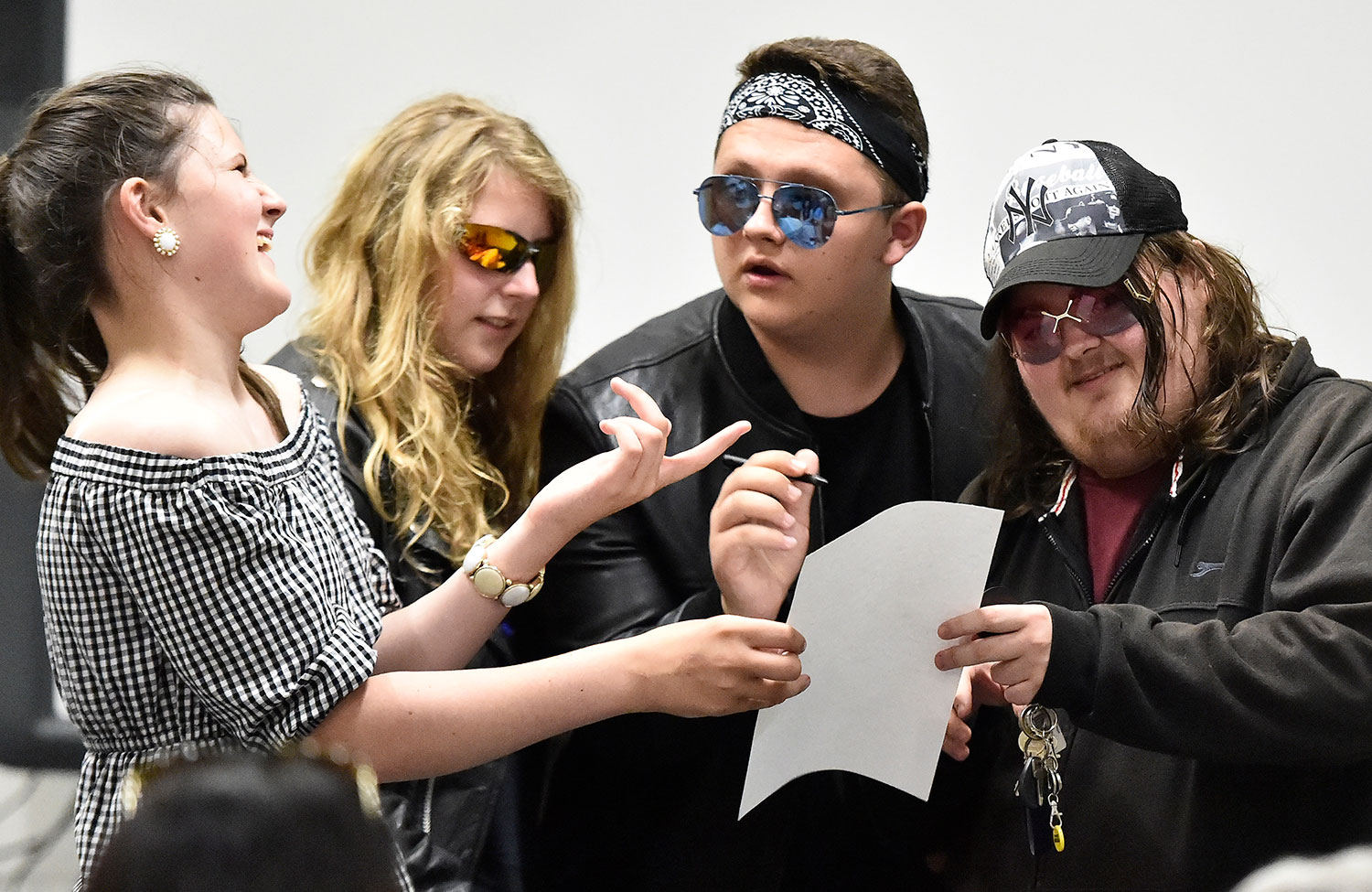 Four young people acting