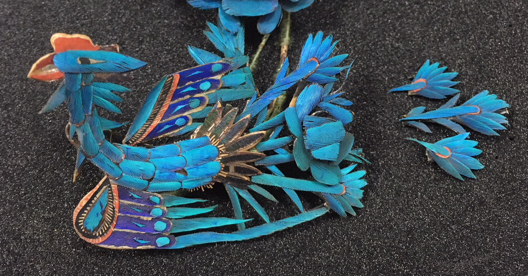 Group of three tail feathers detached from one of the lower phoenixes, before conservation.