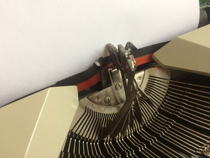Example of type-bar clash on my own Maritsa 30 typewriter from the late 1970s