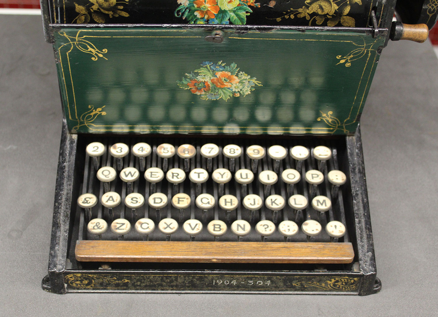The beautifully decorated keyboard cover which reveals the QWERTY arrangement