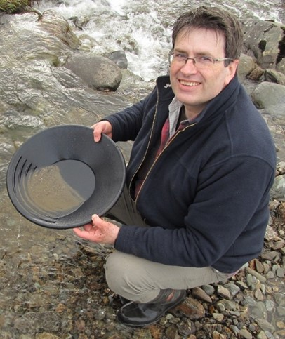 Neil Clark panning for gold in Wanlockhead. He is a curator at The Hunterian Museum, University of Glasgow.