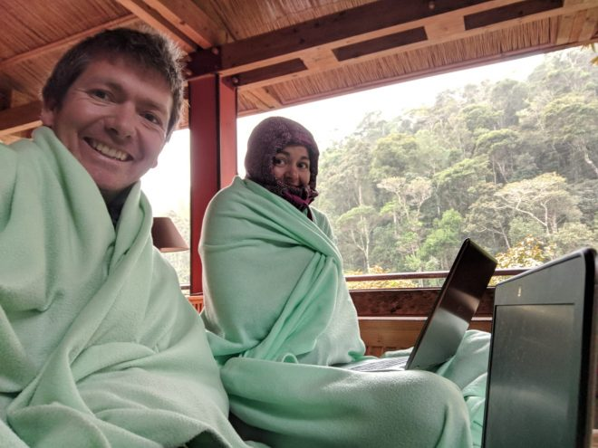 My colleague and I working on our laptops in the main dining area. I had seven layers of clothing under that blanket. Typing was difficult...