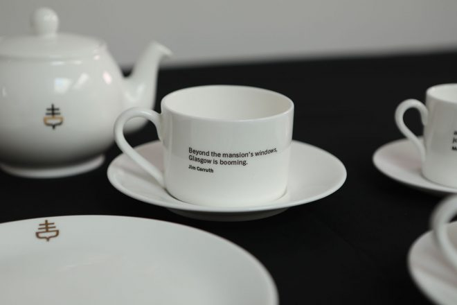 A tea cup from the tea set, inscribed with a poem by Jim Carruth.