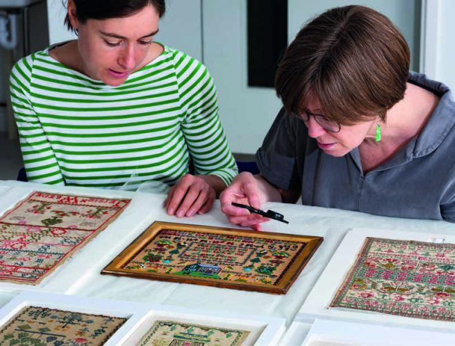 Conservation inspecting the samplers from the Leslie B Durst collection before going on display.