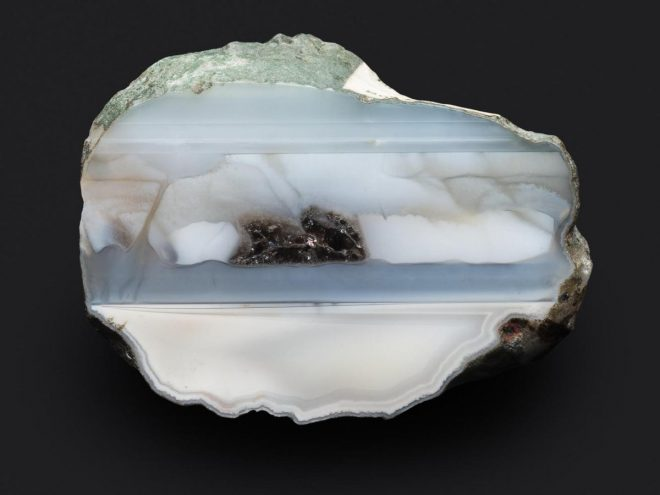 Quartz, variety agate - blue-grey and pale grey zoned and banded onyx with a smoky quartz infill - one face polished - from Blue Hole, Usan, Scurdie Ness, Montrose, Angus