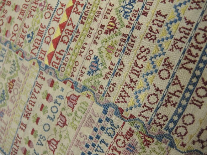 Close-up of the stitching in a sampler from the National Museums Scotland collection.