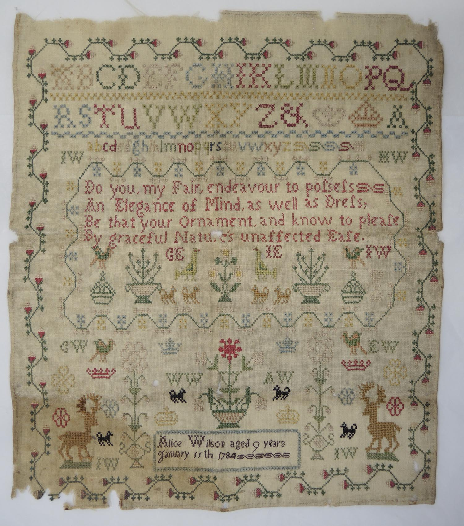 This sampler demonstrates complex condition issues, such as general soiling, staining and areas of loss which are best treated by a textile conservator.