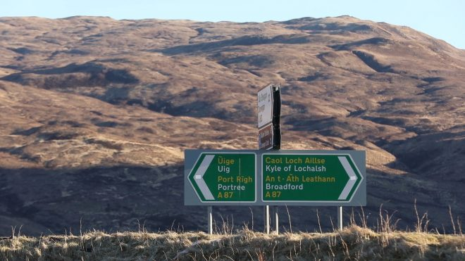 Gaelic-English road sign located by the Old Bridge over the River Sligachan on Skye