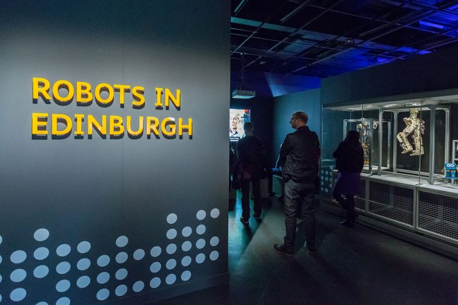 Visitors exploring the 'Robots in Edinburgh' area of the Robots exhibition,