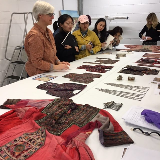 Friederike Voight presenting objects to students at the National Museums Collection Centre.