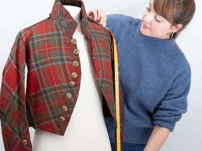 Rosie Nuttall with an early 19th century jacket once worn by a member of the Highland Society of London