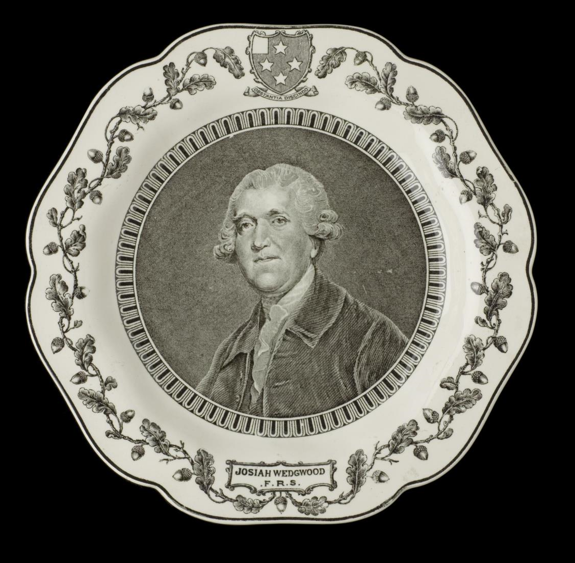 White-glazed transfer-printed earthenware plate with wavy rim, painted in black with an engraved portrait of Josiah Wedgwood after Sir Joshua Reynolds, made to celebrate the 200th anniversary of Wedgwood's birth: English, Staffordshire, Etruria, by Wedgwood, 1930