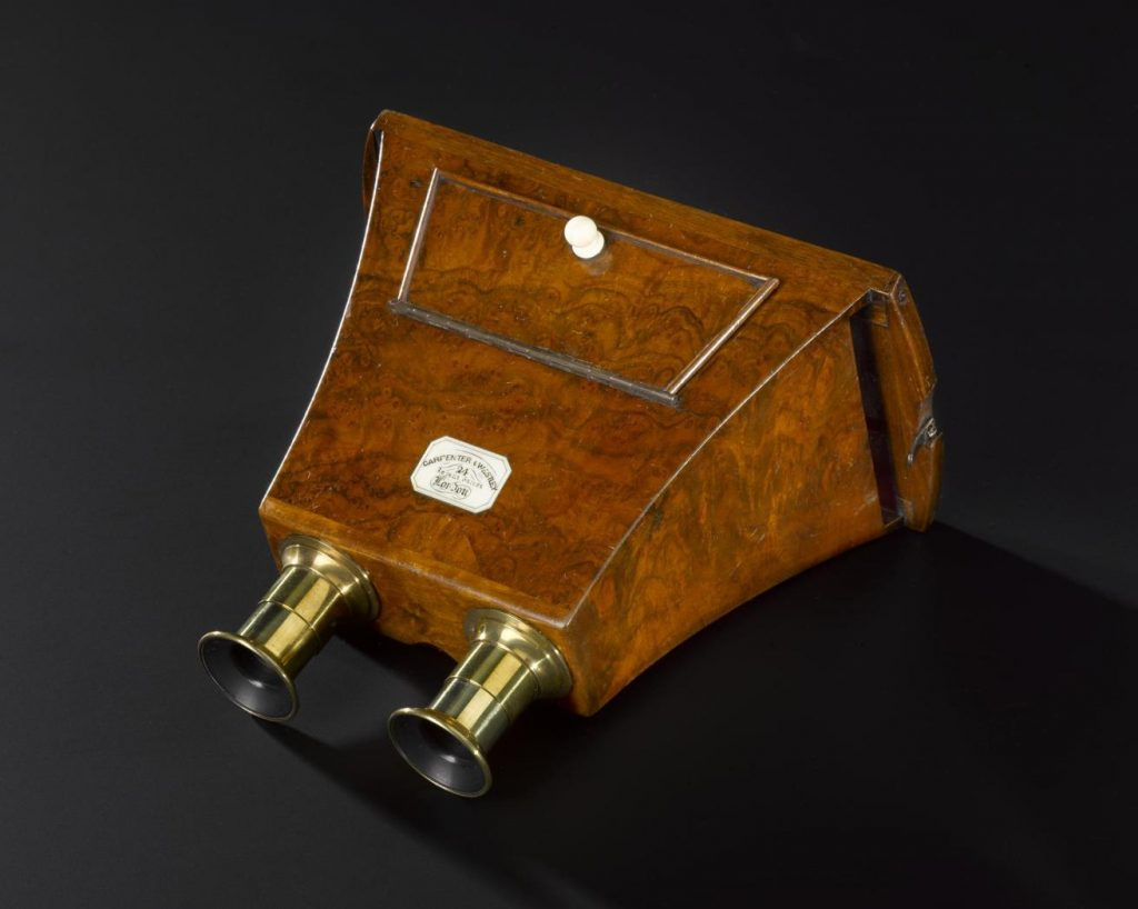 This hand-held stereoscope is made from walnut and came with a pair of lacquered-brass viewing lenses. Made by Carpenter and Westley, London, 1850s–1870s.