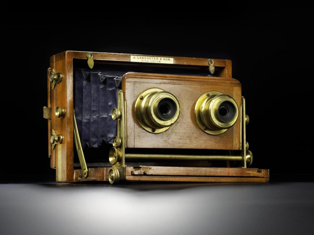 Stereoscopic field camera, with leather bellows, lacquered, brass-bound lenses and three mahogany double darkslides, by Lancaster and Son, 1870s.