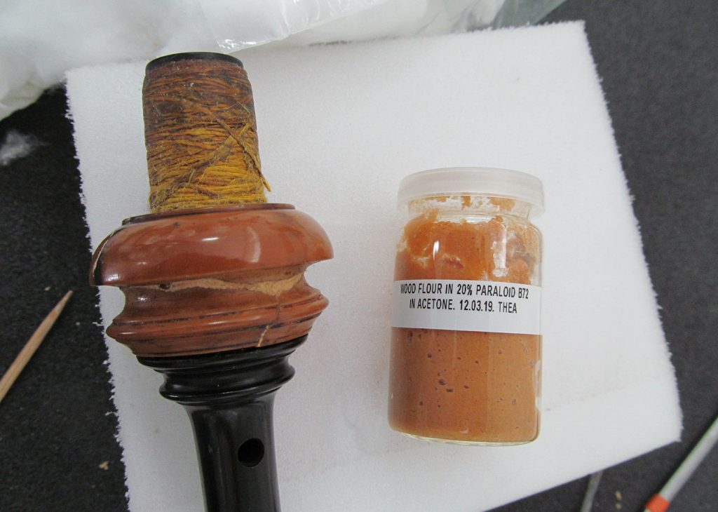 The chanter bone mount after reconstruction and filling with a mix of wood flour and acrylic adhesive in acetone